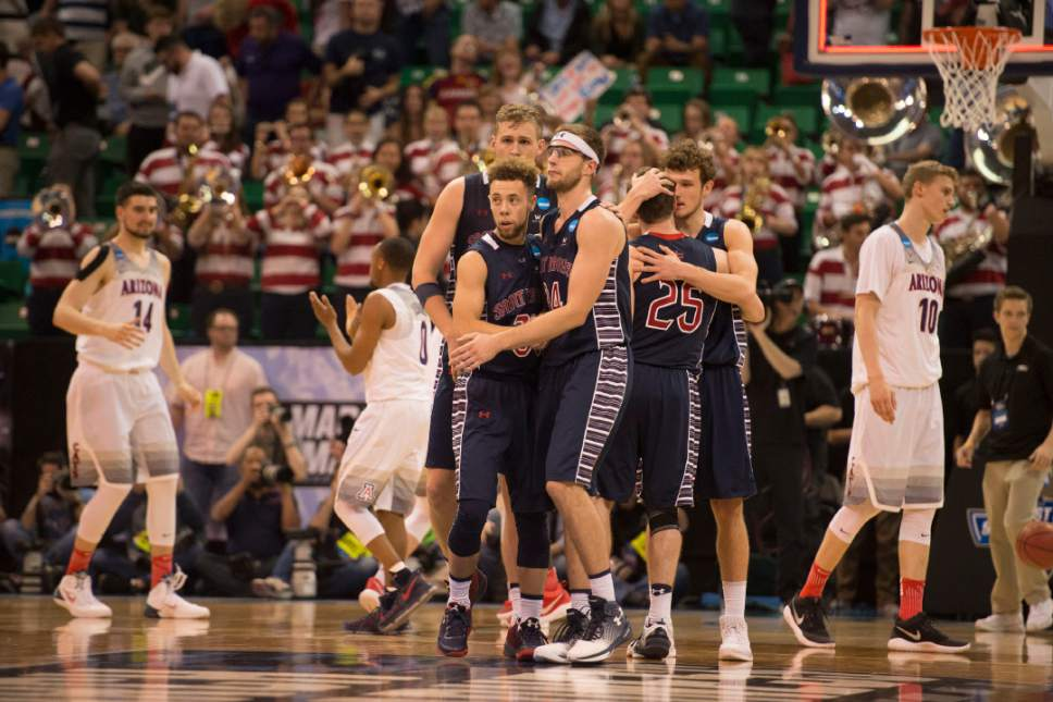 Trent Nelson  |  The Salt Lake Tribune  St. Mary's players console each other after losing to Arizona in the NCAA tournament in Salt Lake City on Saturday, March 18, 2017.