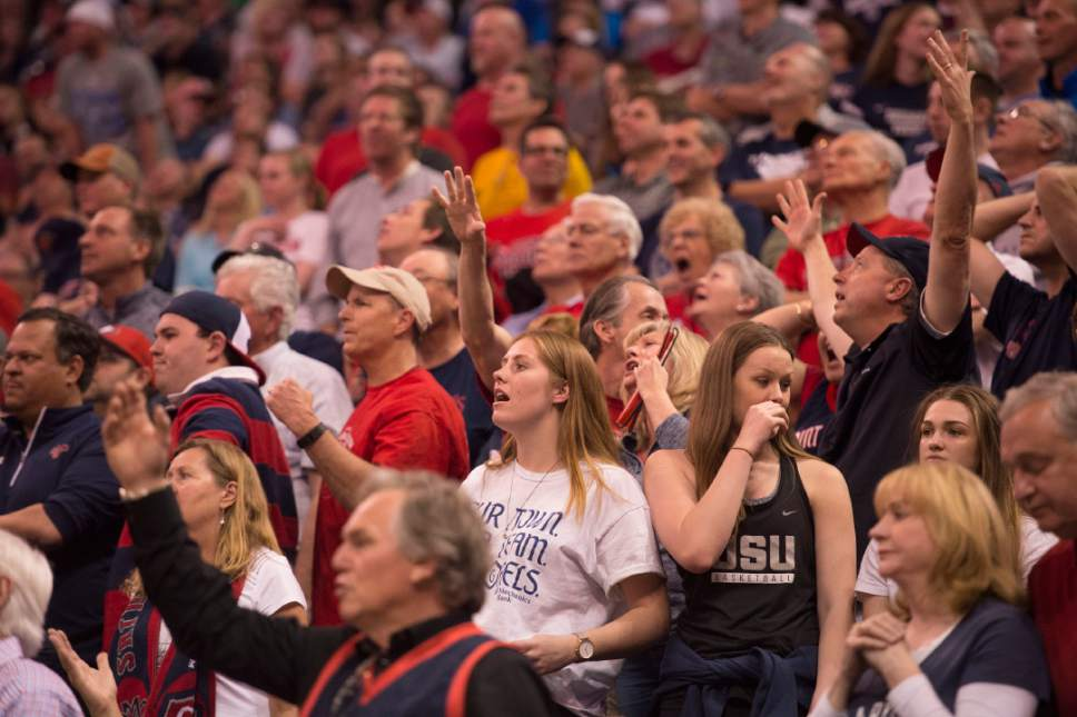 Trent Nelson  |  The Salt Lake Tribune  St. Mary's fans react to a play as they face Arizona in the NCAA tournament in Salt Lake City on Saturday, March 18, 2017.