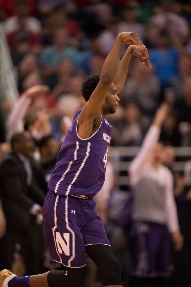 Trent Nelson  |  The Salt Lake Tribune  Northwestern Wildcats forward Vic Law (4) celebrates a three pointer against Gonzaga as the teams face off in the NCAA tournament in Salt Lake City on Saturday, March 18, 2017.