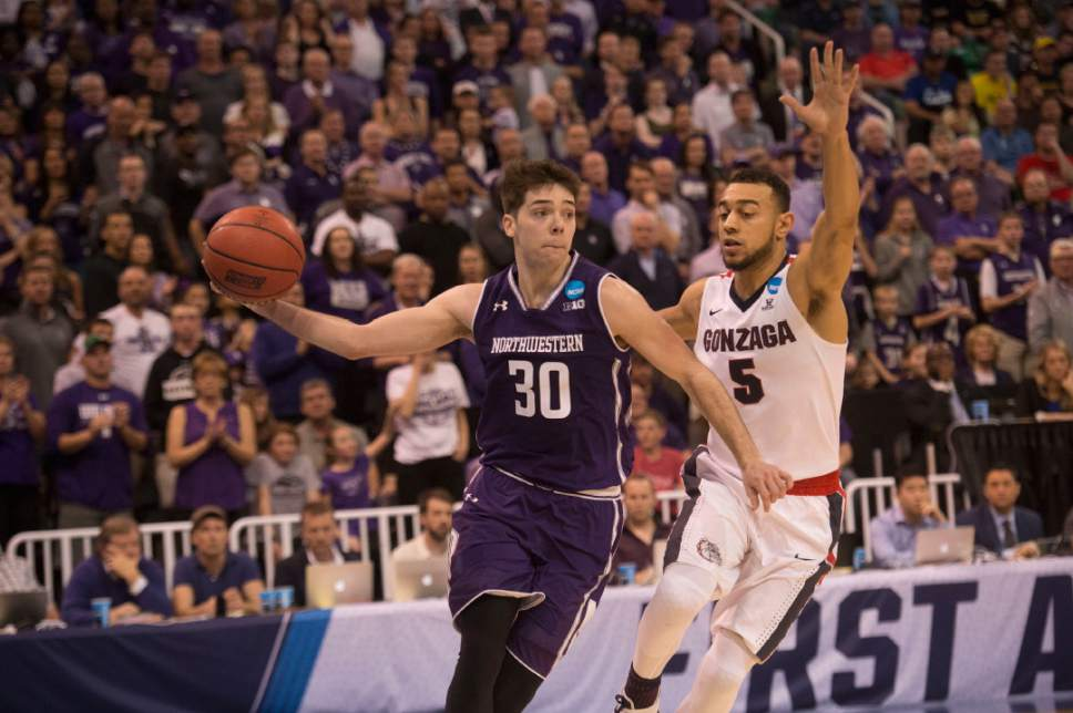 Chris Detrick  |  The Salt Lake Tribune  Northwestern Wildcats guard Bryant McIntosh (30) is defended by Gonzaga Bulldogs guard Nigel Williams-Goss (5) as the teams face off in the NCAA tournament in Salt Lake City on Saturday, March 18, 2017.