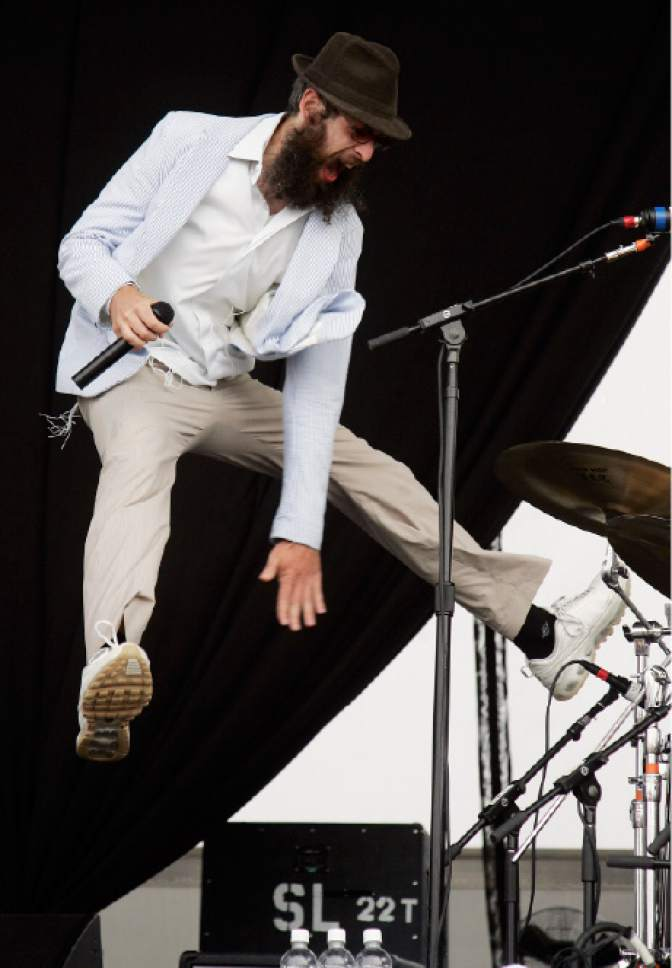 Matisyahu jumps on the stage as he performs at the Virgin Festival in Baltimore, Sunday, Aug. 5, 2007.  (AP Photo/Jeff Christensen)