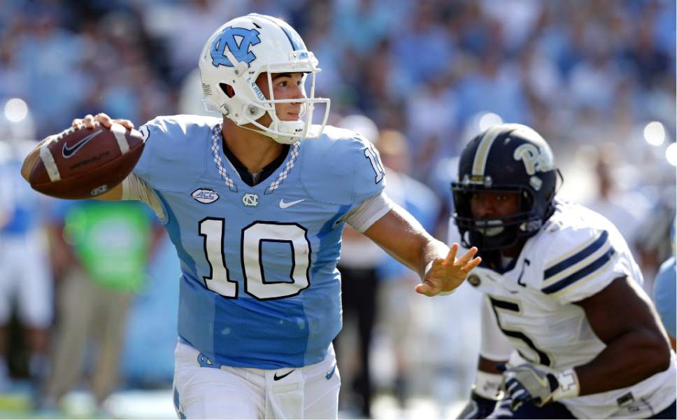FILE - In this Sept. 24, 2016, file photo, North Carolina quarterback Mitch Trubisky (10) throws a pass as Pittsburgh's Ejuan Price (5) rushes during the first half of an NCAA college football game in Chapel Hill, N.C. UNC's takes on Florida State in an ACC matchup on Saturday. (AP Photo/Gerry Broome, File)