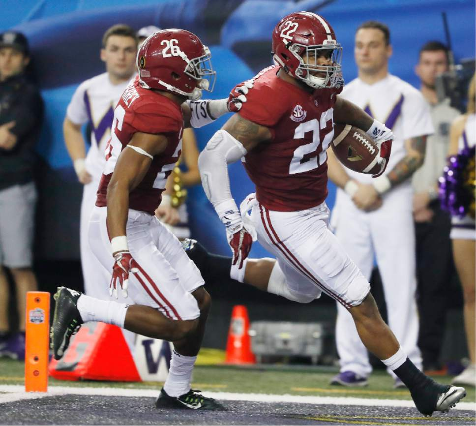 Alabama linebacker Ryan Anderson (22) runs into the end zone for a touchdown with Alabama defensive back Marlon Humphrey (26) against Washington after an interception during the first half of the Peach Bowl NCAA college football playoff game, Saturday, Dec. 31, 2016, in Atlanta. (AP Photo/John Bazemore)