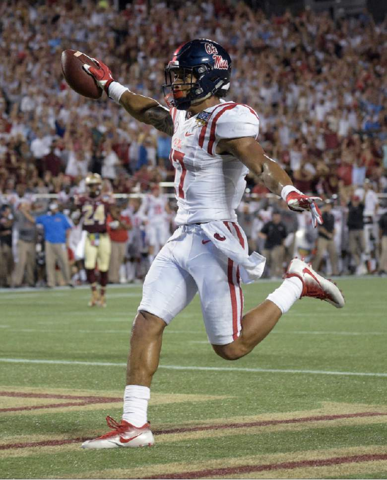Mississippi tight end Evan Engram runs in the end zone after a 21-yard a touchdown reception against Florida State during the first half of an NCAA college football game, Monday, Sept. 5, 2016, in Orlando, Fla. (AP Photo/Phelan M. Ebenhack)