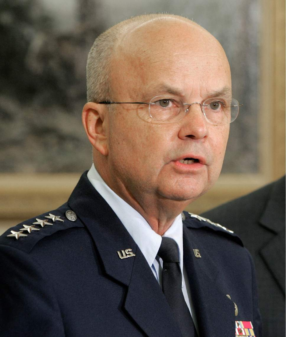 "FILE - In this May 8, 2006 file photo, then-Air Force Gen. Michael Hayden speaks in the Oval Office at the White House in Washington after President Bush announced he was his choice to replace outgoing CIA Director Porter Goss. The head of the CIA during President George W. Bush's second term says ""I didn't lie"" to Congress about harsh interrogations of terrorism suspects. Retired Gen. Michael Hayden does say the intelligence community labored after Sept. 11, 2001 to repel further attacks against the U.S.  (AP Photo/Ron Edmonds, File)"
