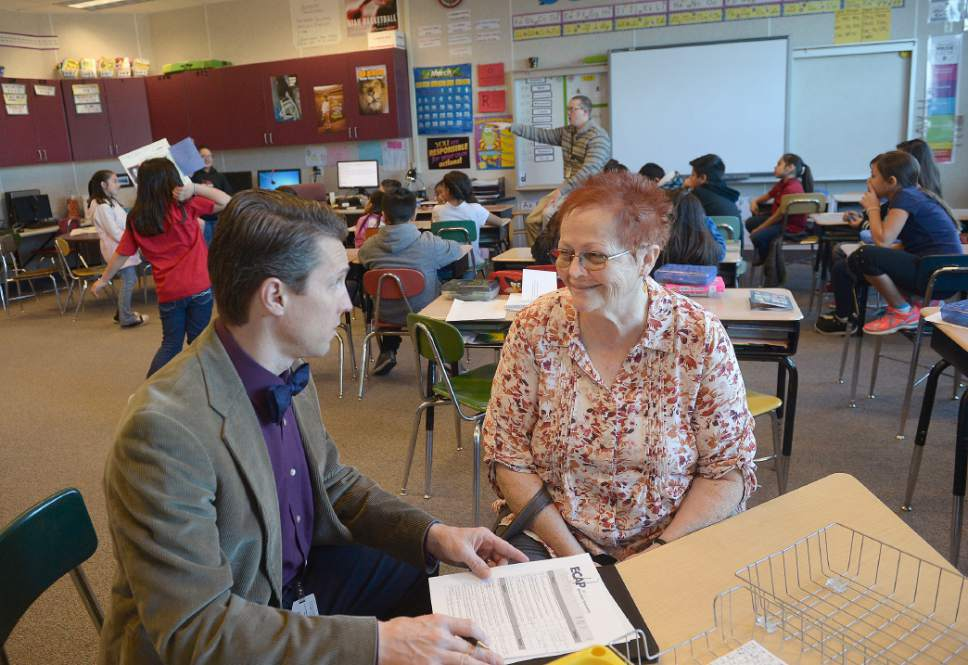 Al Hartmann  |  The Salt Lake Tribune Logan Hall, left, Salt Lake School Distirct Peer Assistance Review supervisor, meets with one of the program's mentor teachers Pat Draper at Bachman Elementary in Salt Lake City.  The teacher mentoring program has boosted staff retention rates but recently lost its state funding. The district plans to continue the program internally.  Draper, a teacher with 40 years of experience mentors Daniel Mills as he teaches his fourth grade class.