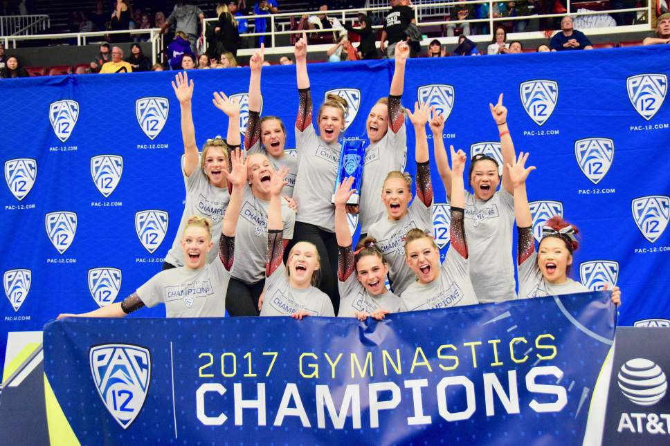 The University of Utah gymnastics team celebrate their 2017 PAC-12 conference championship victory in Maples Pavilion in Stanford, California on Saturday, March 18, 2017. The Red Rocks scored a season-high 197.925 and freshman MyKayla Skinner won the all-around and scored a perfect 10.0 on her floor routine en route to the title. Courtesy Photo | Deena Lofgren/University of Utah Gymnastics