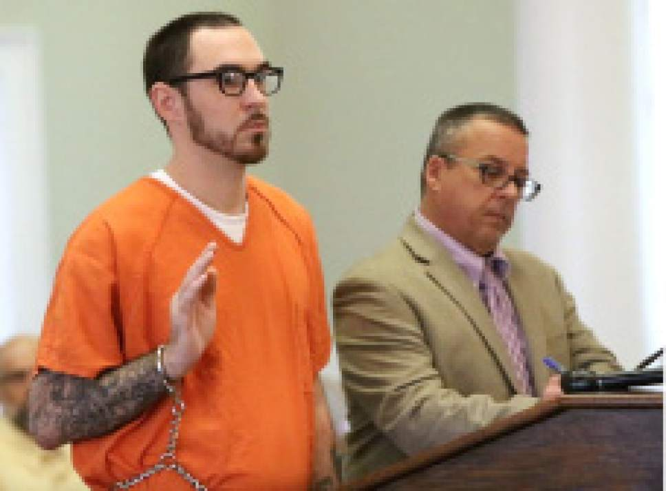 In this July 12, 2016 photo, Josh Vallum is sworn in before pleading guilty in George County Circuit Court in Lucedale, Miss., to a charge of first-degree murder by deliberate design for killing Mercedes Williamson, 17, a transgender woman of Theodore, Ala. At right is public defender David Futch. Vallum, an ex-convict and top-ranking gang member, faces life in prison without parole for killing Williamson. (John Fitzhugh/The Sun Herald via AP)