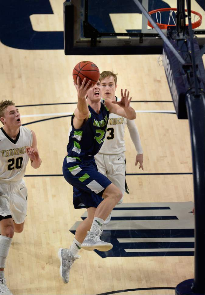 Scott Sommerdorf | The Salt Lake Tribune  Jaxon Brenchley drives to make a layup during first half play. Ridgeline beat Desert Hills 64-60 in a Boy's 3A semi-final playoff played at USU, Friday, February 24, 2017.