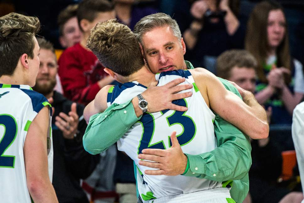 Chris Detrick  |  The Salt Lake Tribune Ridgeline's Jaxon Brenchley (23) gets a hug from coach Graydon Buchmiller during the 3A boys' basketball state championship game at Dee Glen Smith Spectrum at Utah State University Saturday February 25, 2017. Ridgeline defeated Juan Diego 89-63.