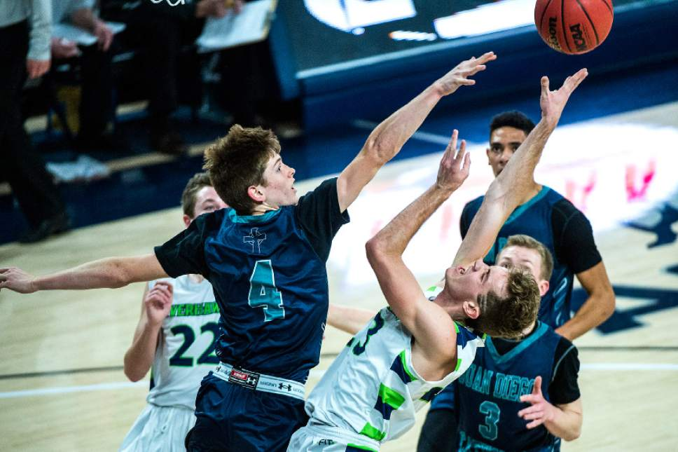 Chris Detrick  |  The Salt Lake Tribune Juan Diego's JD Ahlstrom (4) fouls Ridgeline's Jaxon Brenchley (23) during the 3A boys' basketball state championship game at Dee Glen Smith Spectrum at Utah State University Saturday February 25, 2017.