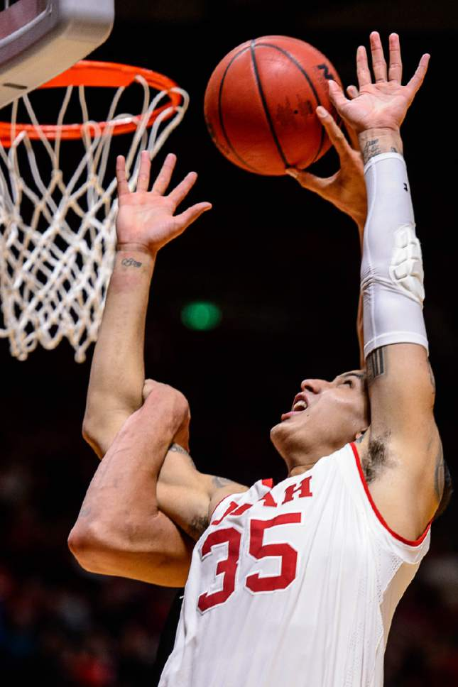 Trent Nelson  |  The Salt Lake Tribune Utah Utes forward Kyle Kuzma (35) reaches for the ball as the University of Utah hosts Oregon State, NCAA basketball at the Huntsman Center in Salt Lake City, Saturday January 28, 2017.