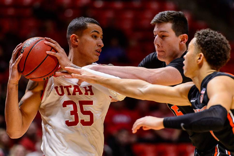 Trent Nelson  |  The Salt Lake Tribune Utah Utes forward Kyle Kuzma (35) is fouled in the final minute. Oregon State Beavers forward Drew Eubanks (12) and Oregon State Beavers guard Jaquori McLaughlin (0) in on the play as the University of Utah hosts Oregon State, NCAA basketball at the Huntsman Center in Salt Lake City, Saturday January 28, 2017.