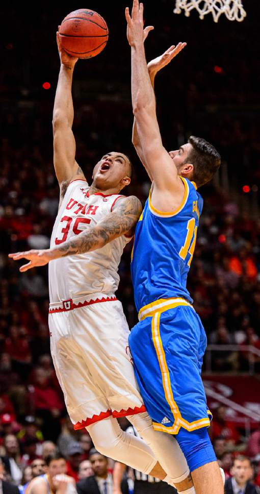 Trent Nelson  |  The Salt Lake Tribune Utah Utes forward Kyle Kuzma (35) shoots over UCLA Bruins forward Gyorgy Goloman (14) as the University of Utah hosts UCLA, NCAA mens basketball at the Huntsman Center in Salt Lake City, Saturday January 14, 2017.