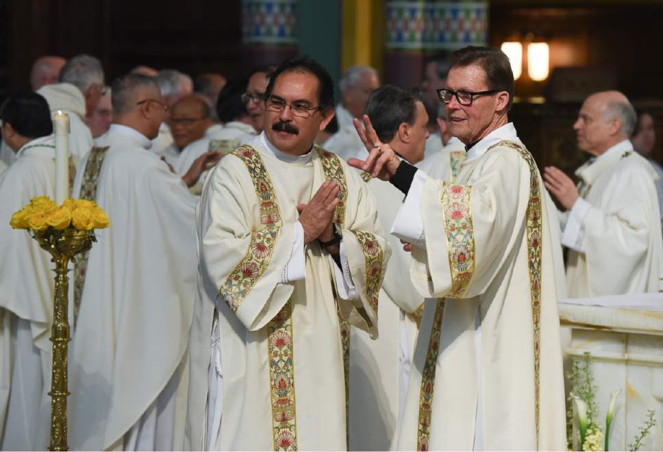 Gods providence brings new catholic bishop to his place among francisco kjolseth the salt lake tribune priests greet one another as they extend a sign m4hsunfo