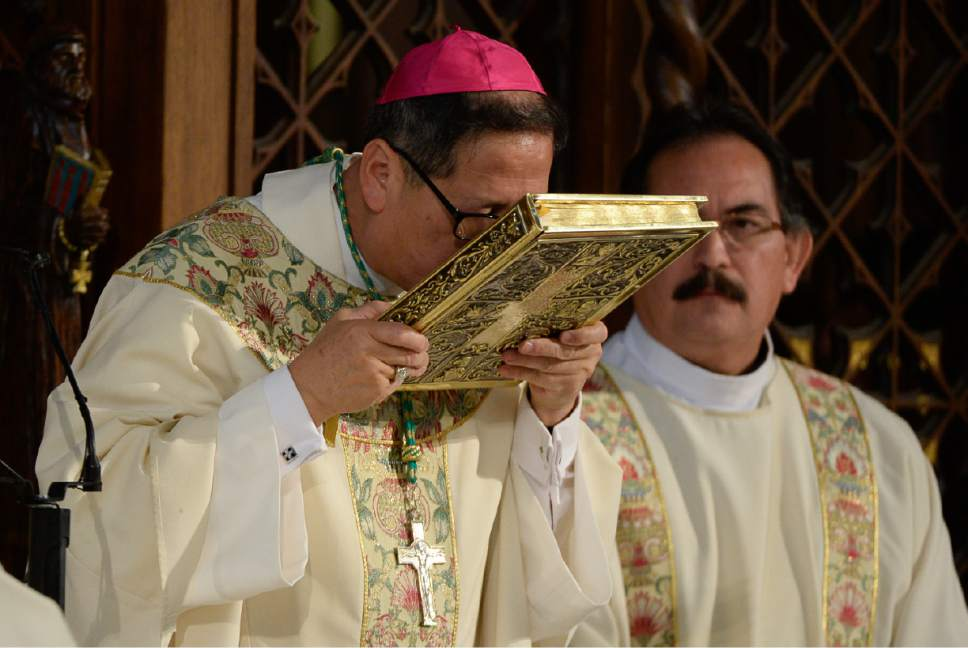 Francisco Kjolseth | The Salt Lake Tribune Bishop Oscar A. Solis kisses the Book of Gospels during his official installation at the 10th bishop of the Diocese of Salt Lake City.
