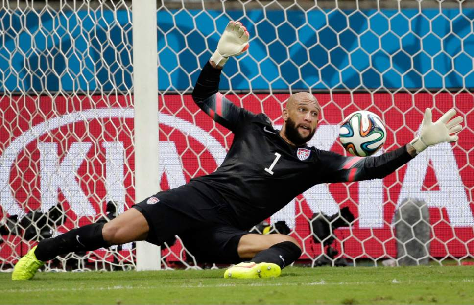FILE - In this July 1, 2014, file photo, United States' goalkeeper Tim Howard saves a shot by Belgium during a World Cup round of 16 soccer match at the Arena Fonte Nova in Salvador, Brazil. Howard, DaMarcus Beasley and Clint Demspey have been around with Bruce Arena since the last time the U.S. coach guided the Americans into World Cup qualifying, way back 12 years ago. Now, these three will be counted upon to help lead the Americans in their World Cup qualifier Friday against Honduras in San Jose, Calif.  (AP Photo/Felipe Dana, File)