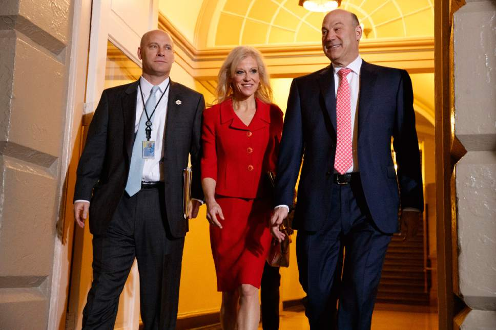 White House Senior Adviser Kellyanne Conway, center, and National Economic Council director Gary Cohn arrive for a meeting on Capitol Hill in Washington, Tuesday, March 21, 2017, between President Donald Trump and Republicans to discuss health care. (AP Photo/Evan Vucci)