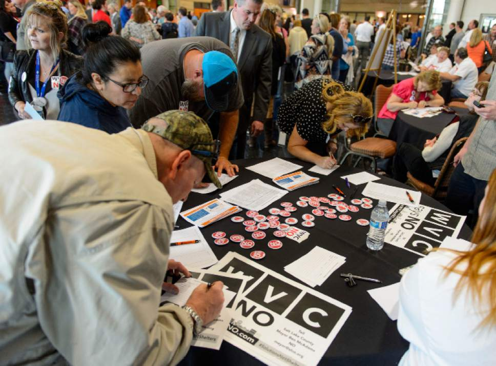 Steve Griffin  |  The Salt Lake Tribune   West Valley City citizens sign a petition against proposed homeless shelters in their city as they attend an open house at the Utah Cultural Celebration Center in West Valley City Tuesday March 21, 2017.