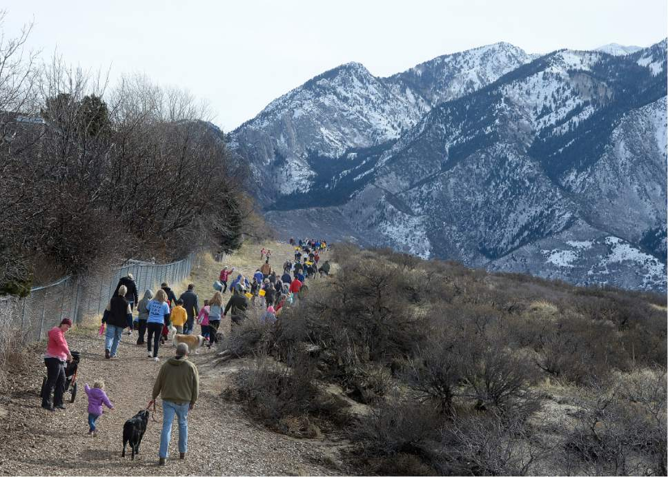 "Scott Sommerdorf  |  Tribune file photo Hikers walk during ""March For The Park"" earlier this month as part of an effort to work against a $4 Million 3-mile asphalt trail through Dimple Dell Regional Park in Sandy."