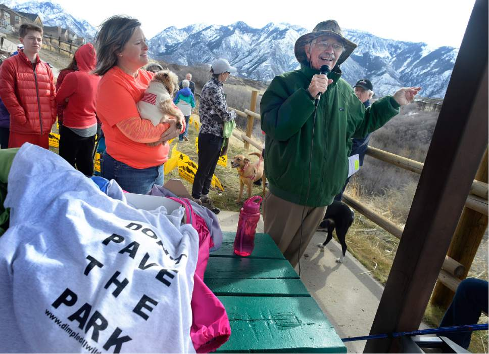 "Scott Sommerdorf |  Tribune file photo Organizer Monica Zoltanski, left, listens as naturalist Ty Harrison speaks about the unique features of the Dimple Dell area.  Hikers later walked during ""March For The Park!"" - an effort to work against a $4 Million 3-mile asphalt trail through Dimple Dell Regional Park in Sandy, Saturday, March 4, 2017. They are hiking east from the Wrangler Trailhead (10400 South 13000 East). The group had organized the event to support its petition effort and to inform park users of the unique characteristics found in Dimple Dell Park that it aims to preserve."