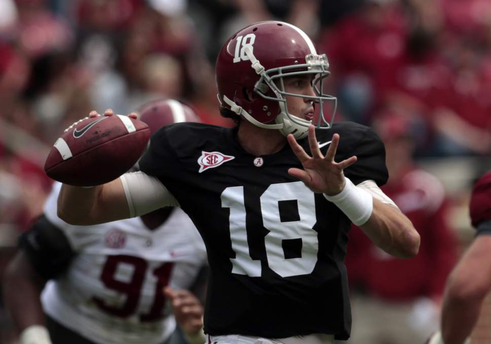 Alabama quarterback Cooper Bateman (18) throws a pass during the first half of Alabama's spring NCAA college football game, Saturday, April 18, 2015, in Tuscaloosa, Ala. (AP Photo/Butch Dill)