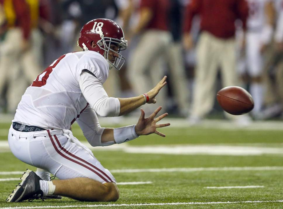 Alabama quarterback Cooper Bateman (18) prepares to catch the snap for a field goal during the second half of the Southeastern Conference championship NCAA college football game against Florida, Saturday, Dec. 3, 2016, in Atlanta.(AP Photo/Butch Dill)