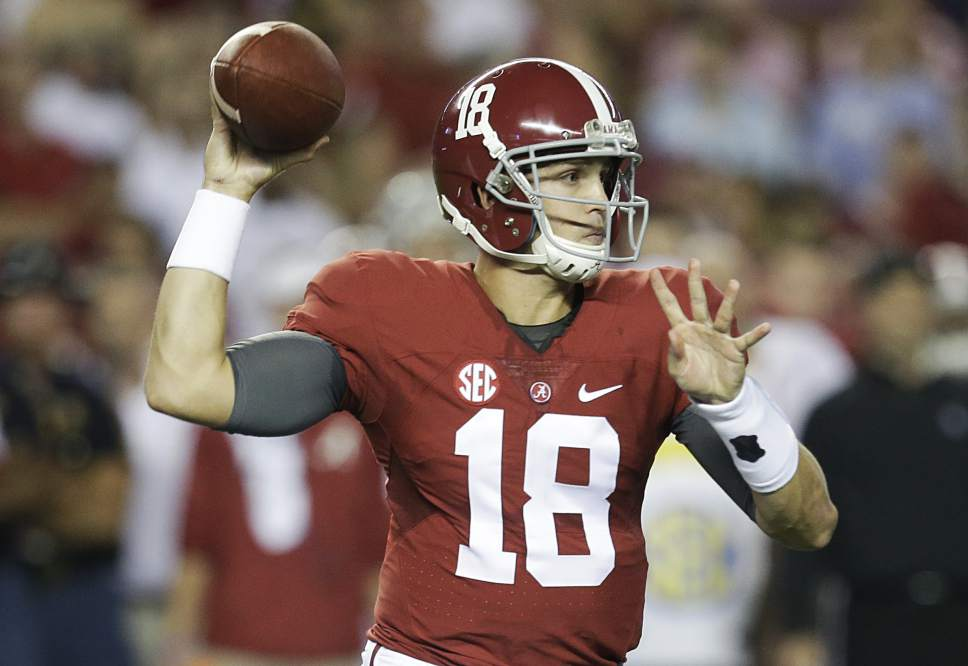 FILE - In this Sept. 19, 2015, file photo, Alabama quarterback Cooper Bateman passes the ball during the first half of an NCAA football game against Mississippi, in Tuscaloosa, Ala. (AP Photo/Butch Dill, File)