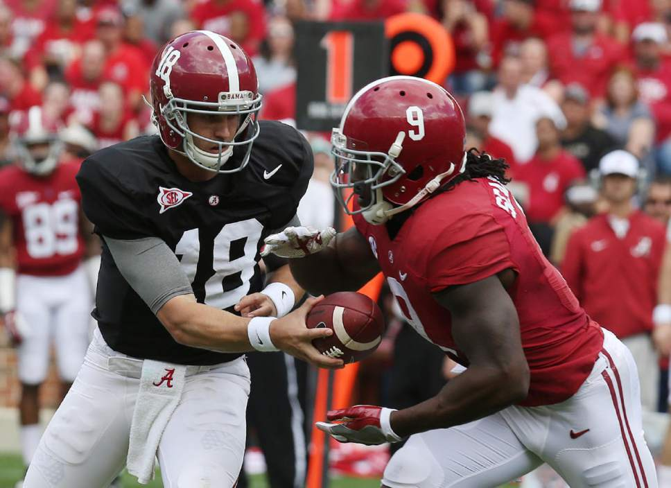 Alabama quarterback Cooper Bateman hands the ball to running back Bo Scarbrough during an NCAA college spring football game at Bryant-Denny Stadium in Tuscaloosa, Ala. on Saturday April 16, 2016. (Erin Nelson/The Tuscaloosa News via AP) NO SALES; MANDATORY CREDIT