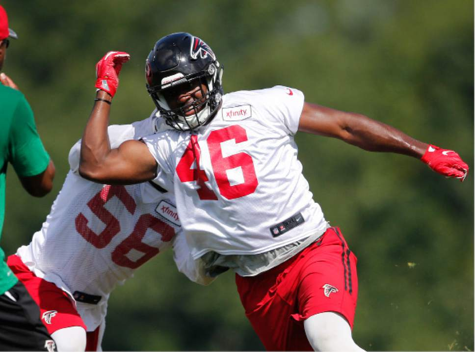FILE - In this June 29, 2016, file photo, Atlanta Falcons linebacker Torrey Green (46) and linebacker Sean Weatherspoon (56) work a drill during an NFL football practice, in Flowery Branch, Ga. The Falcons have cut rookie free agent linebacker Torrey Green as Utah law enforcement authorities investigate allegations of sexual assault made against him while he was a student at Utah State last year. Falcons owner Arthur Blank said Green was cut Thursday morning, Aug. 4, 2016,  after the team learned of the allegations the night before. (AP Photo/John Bazemore, File)