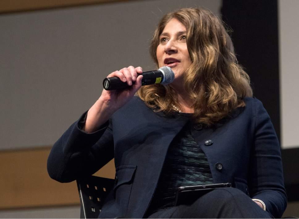 "Rick Egan  |  The Salt Lake Tribune Salt Lake Tribune Editor Jennifer Napier- Pearce moderates a panel discussion during the  ""Fake or Fact: What is News?"" forum at the Salt Lake Public Library on Wednesday."