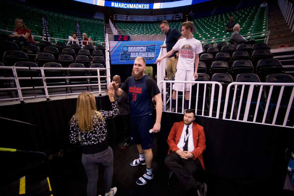 Trent Nelson |  The Salt Lake Tribune  Gonzaga Bulldogs center Przemek Karnowski (24) high fives a fan as the team practices during NCAA Tournament in Salt Lake City on Wednesday, March 15, 2017.