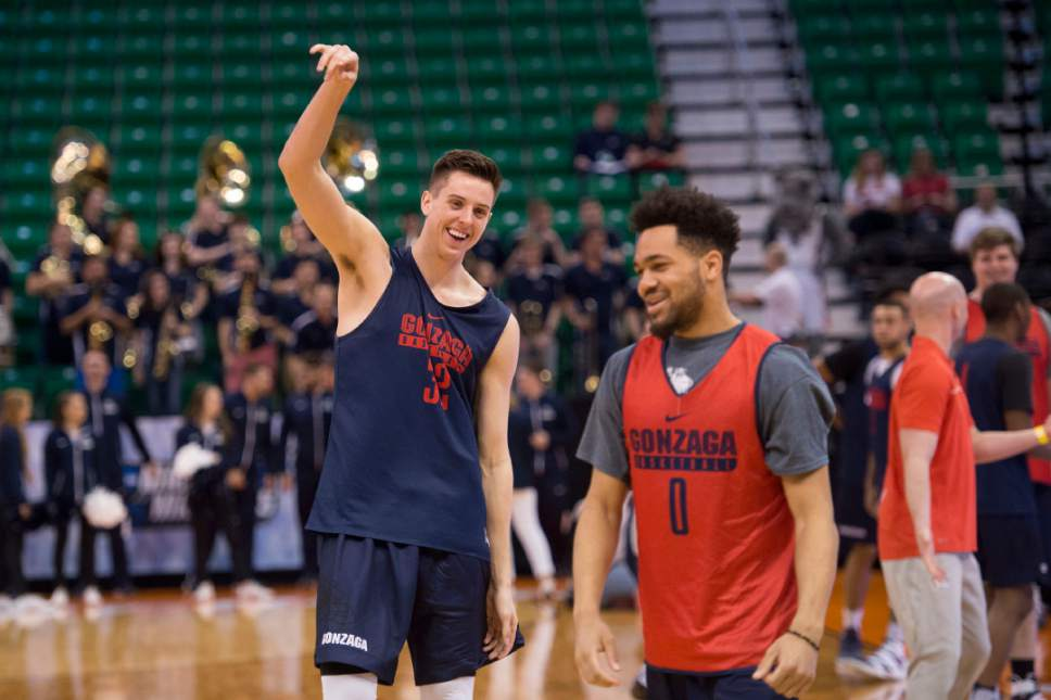 Trent Nelson |  The Salt Lake Tribune  Gonzaga Bulldogs forward Zach Collins (32) laughs with Gonzaga Bulldogs guard Silas Melson (0) as the team practices during NCAA Tournament in Salt Lake City on Wednesday, March 15, 2017.