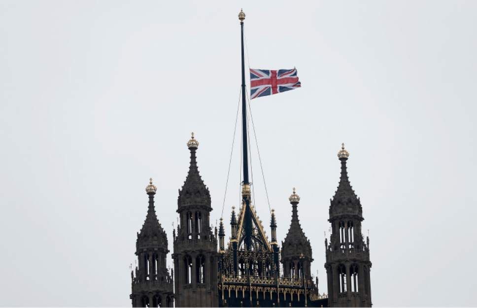 The flag flies at half staff above The House of Lords following Wednesday's attack in London, Thursday March 23, 2017.  On Wednesday a knife-wielding man went on a deadly rampage, first  driving a car into pedestrians before stabbing a police officer to death and then was fatally shot by police within Parliament's grounds in London.  Five people were killed, including the assailant.(AP Photo/Kirsty Wigglesworth)