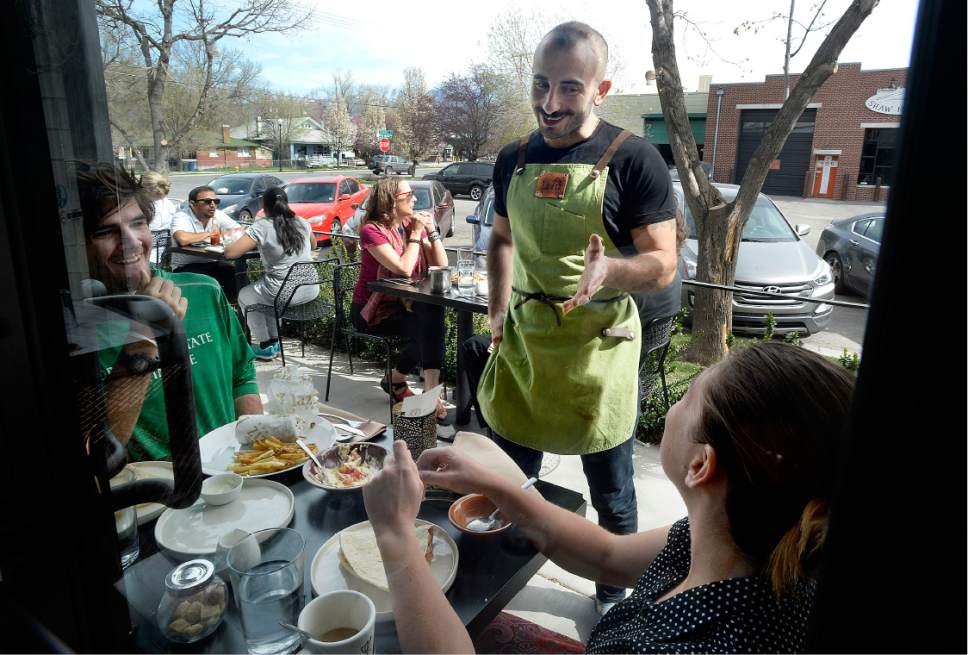 Scott Sommerdorf | The Salt Lake Tribune Co-owner Moudi Sbeity stops to speak with diners on the patio at Laziz Kitchen in Salt Lake City's Central Ninth neighborhood on Sunday, March 19, 2017.