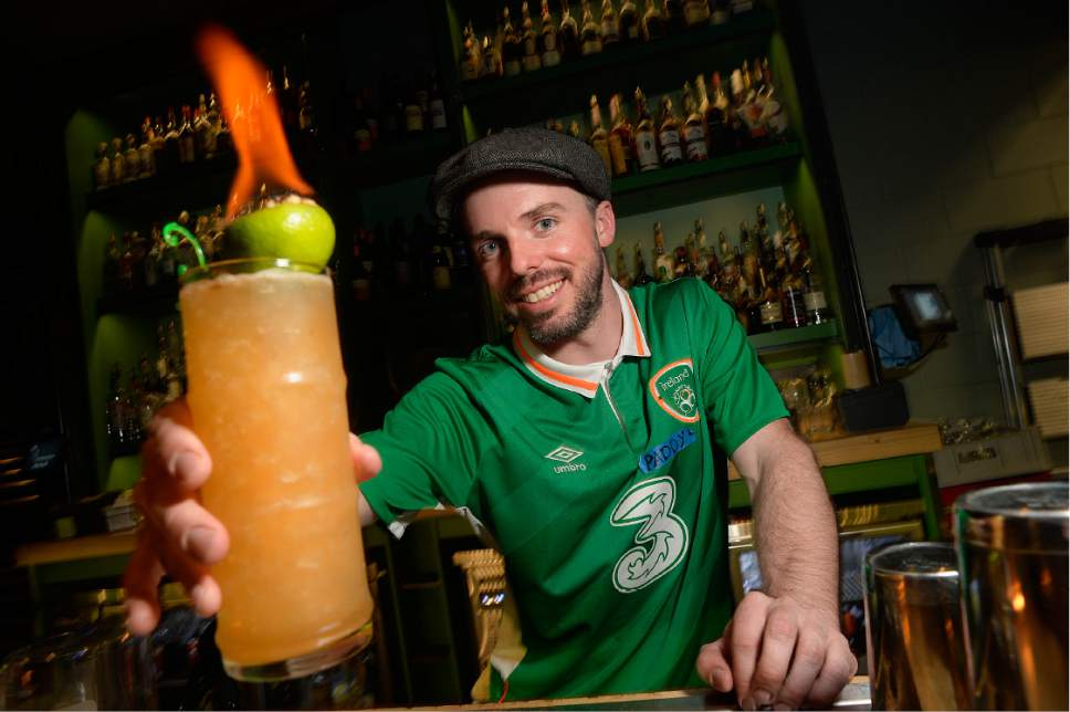 Scott Sommerdorf | The Salt Lake Tribune Bartender Pat Harrington serves a flaming Mai Tai at Water Witch on March 17.