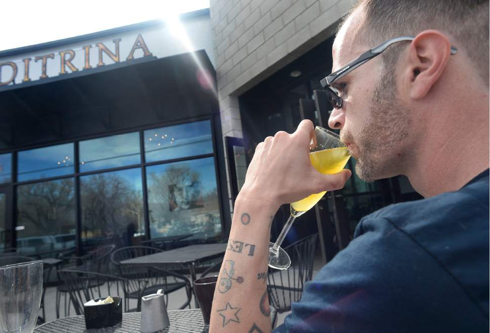 Scott Sommerdorf | The Salt Lake Tribune Cory Stephens sips a drink on the patio at Meditrina in Salt Lake City's Central Ninth neighborhood on Sunday, March 19, 2017.