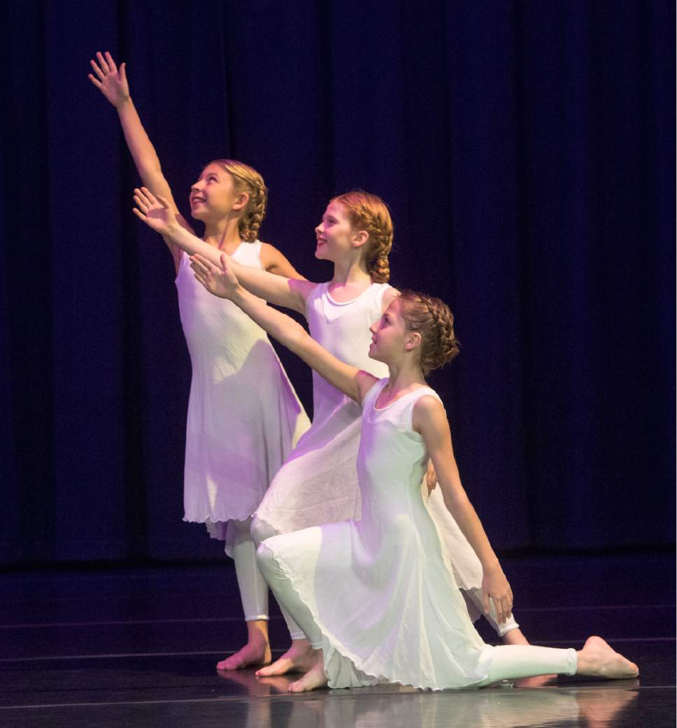 """Rick Egan     The Salt Lake Tribune  Charlotte Bean, Isabell Pugsley and Rachel Perry, a rehearse for Children's Dance Theatre's upcoming production of """"Elfwyn's Saga,"""" a new work that brings to life a story by David Wisiniewski. Monday, March 20, 2017."""