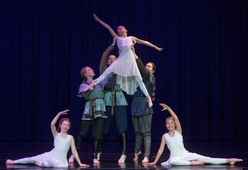 """Rick Egan     The Salt Lake Tribune  Faith Jackson, Megan Prince, and Amanda Edwards lift Rachel Perry, as Isabell Pugsley and Charlotte Bean, sit on the floor, during a rehearsal for Children's Dance Theatre's upcoming production of """"Elfwyn's Saga,"""" a new work that brings to life a story by David Wisiniewski. Monday, March 20, 2017."""
