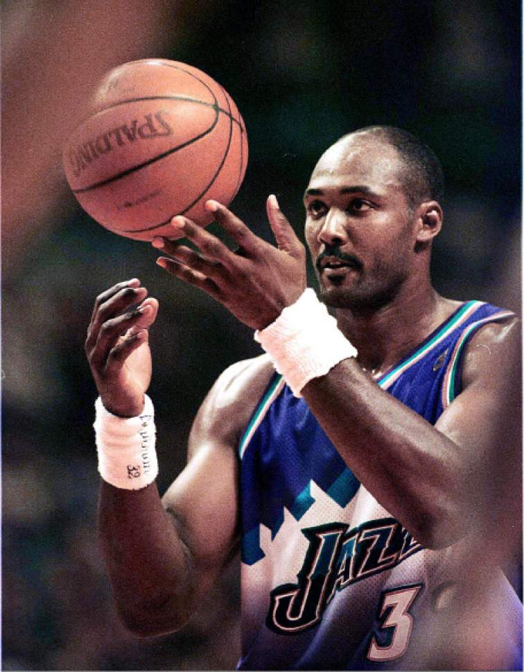 363ddbe7946b Karl Malone flips the ball into the air as he readys himself for the first  of