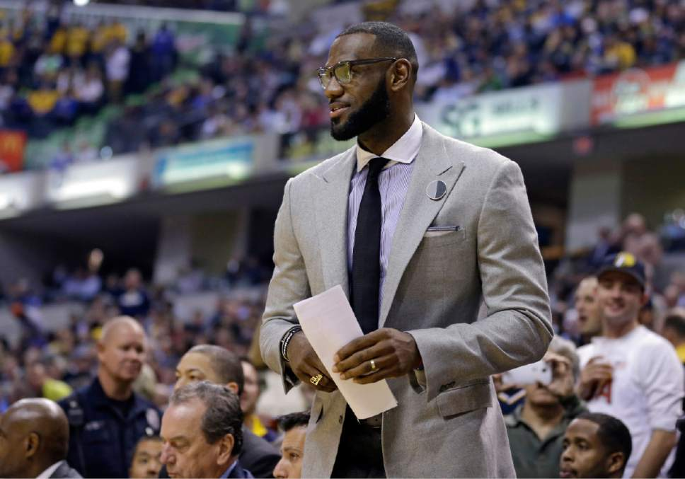 e42262c1420c Cleveland Cavaliers forward LeBron James watches from the bench during the  first half of the team s