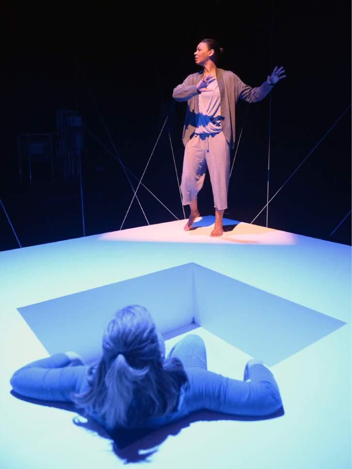 "Al Hartmann     The Salt Lake Tribune Colleen Baum, below, and Latoya Cameron in Plan-B Theatre's ""Not One Drop"" by Morag Shepherd."