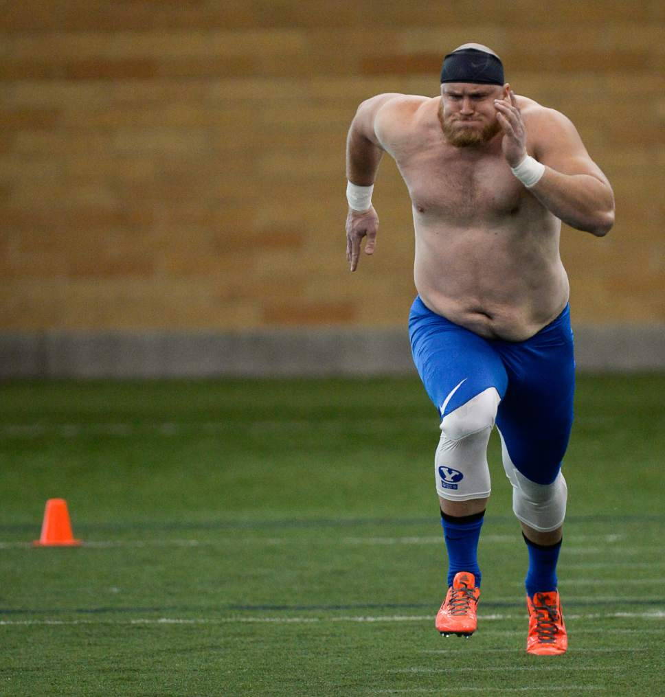 Francisco Kjolseth   The Salt Lake Tribune Offensive lineman Andrew Eide pushes through the 40-yard run as BYU's Pro Day kicks off at the indoor practice facility with seniors performing in front of NFL scouts.