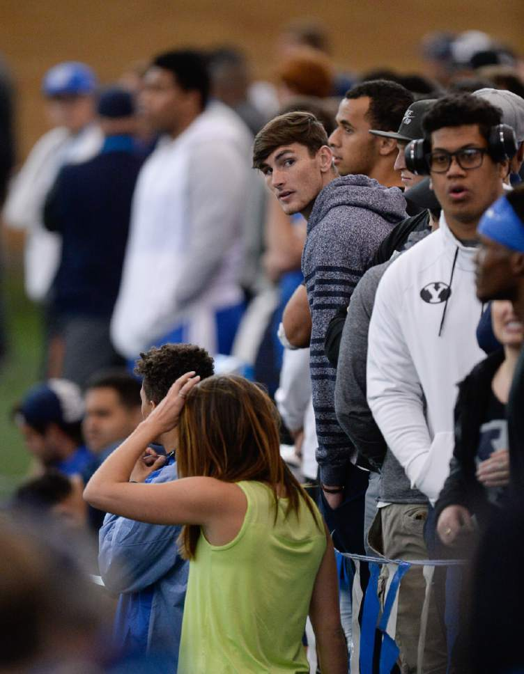 Francisco Kjolseth   The Salt Lake Tribune Fans come out for BYU's Pro Day at the indoor practice facility as seniors perform in front of NFL scouts.