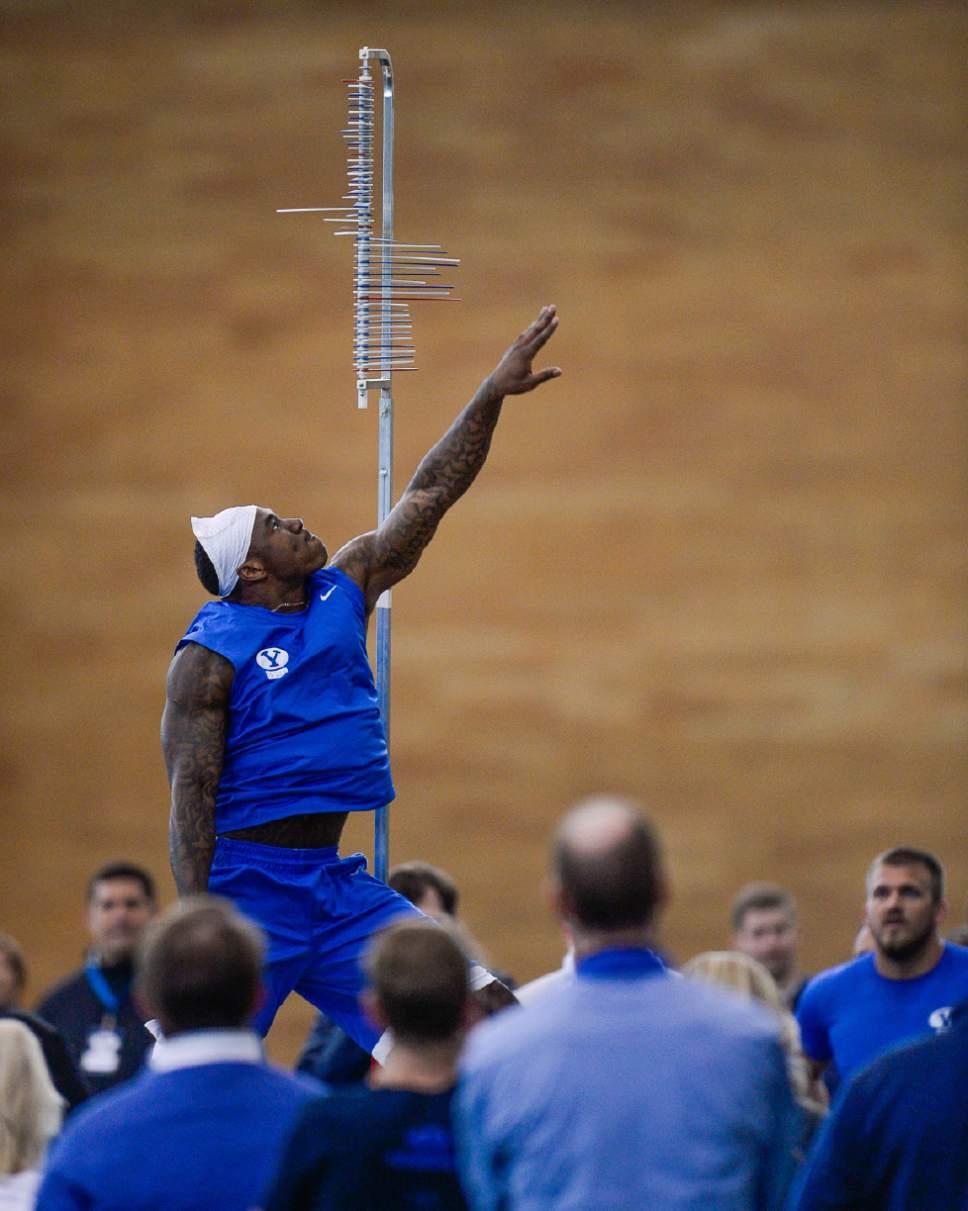 Francisco Kjolseth   The Salt Lake Tribune Running Back Jamaal Williams reaches high for the vertical jump as BYU's Pro Day kicks off at the indoor practice facility with seniors performing in front of NFL scouts.