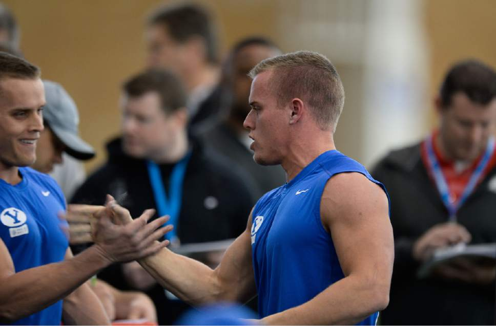 Francisco Kjolseth   The Salt Lake Tribune Mitchell, left, and Garrett Juergens support one another as BYU's Pro Day kicks off at the indoor practice facility as seniors perform in front of NFL scouts.