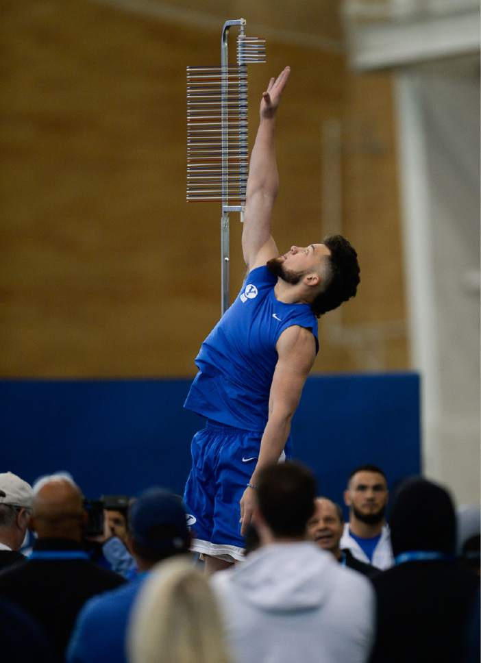 Francisco Kjolseth   The Salt Lake Tribune Defensive back Kai Nacua reaches high for the vertical jump as BYU's Pro Day kicks off at the indoor practice facility with seniors performing in front of NFL scouts.