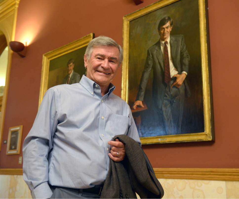Al Hartmann  |  The Salt Lake Tribune Former Salt Lake City Mayor Ted Wilson stands beside his official portrait in the hallway outside the Mayor's office in the City-County building Monday March 20. He served three terms as mayor from 1976-1985 before becoming director for the Hinckley Insititute of Politics.  Wilson is 76 years old now, a bit grayer but still enjoys bicycling, rock climbing and skiing.