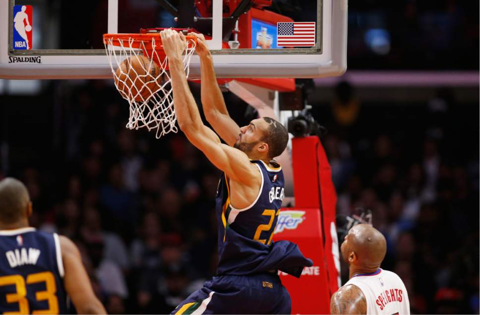 Utah Jazz center Rudy Gobert, center, dunks the ball above Los Angeles Clippers center Marreese Speights, right, during the second half of an NBA basketball game, Saturday, March 25, 2017, in Los Angeles. The Clippers won 108-95. (AP Photo/Danny Moloshok)