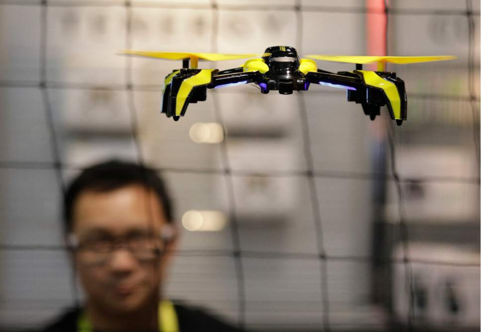 FILE - In this Jan. 5, 2017 file photo, a drone flies  in Las Vegas. The world's largest manufacturer of civilian drones is proposing that drones be required to continually transmit identification information to help government security agencies and law enforcement figure out which might belong to rogue operators. (AP Photo/John Locher, File)